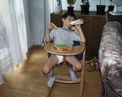 8 year old diaper boy Tommy wearing diapers and sucking pacifier